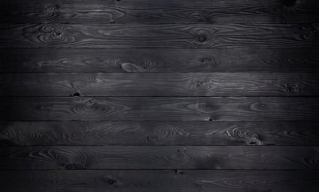 Trama di assi di legno nero in legno vecchio