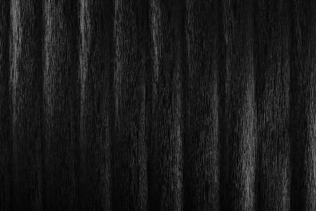 Texture di carta stropicciata nera con luce soffusa.