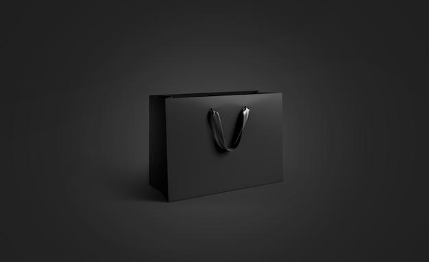Sacchetto di carta nero vuoto con manico in seta, isolato