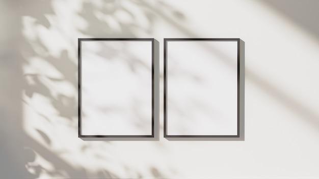 Cornici verticali nere vuote simulano con foglie ombre e luce solare sullo sfondo della parete bianca, rendering 3d