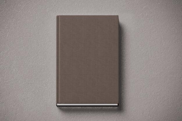 Libro con copertina rigida in tessuto marrone vuoto mock up, lato anteriore