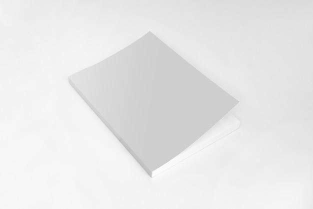 Modello di libro copertina vuota su sfondo grigio