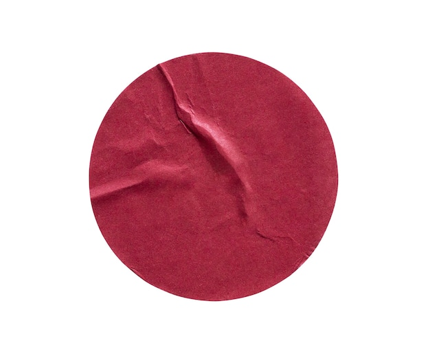 Etichetta adesiva di carta adesiva rotonda rossa in bianco isolata su priorità bassa bianca
