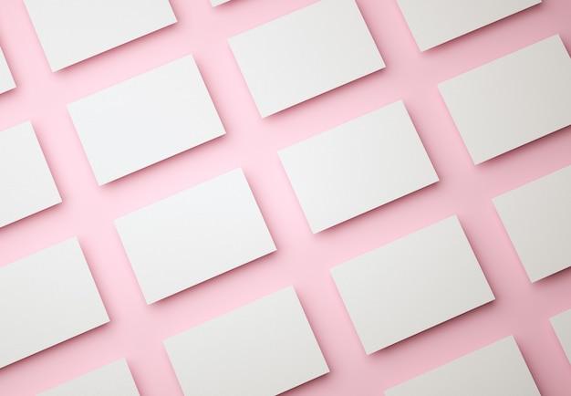 Modello di progettazione di biglietti da visita bianchi vuoti su rosa