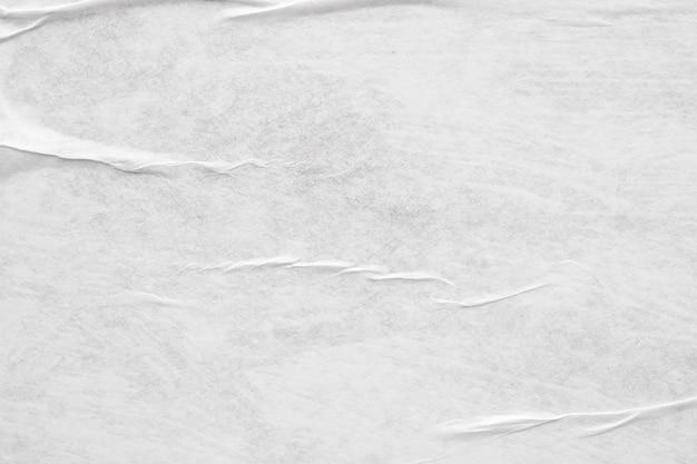 Priorità bassa di struttura del manifesto di carta sgualcita e sgualcita bianco vuoto