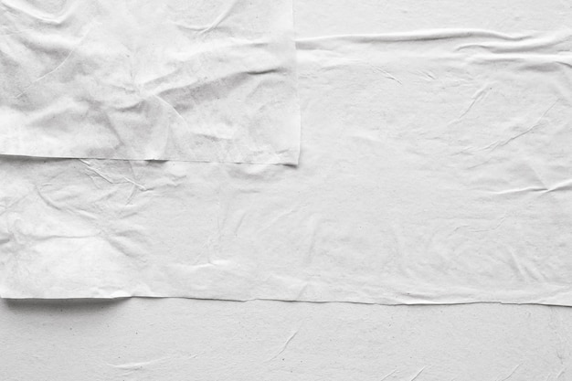 Priorità bassa di struttura del manifesto di carta sgualcita bianca vuota e sgualcita