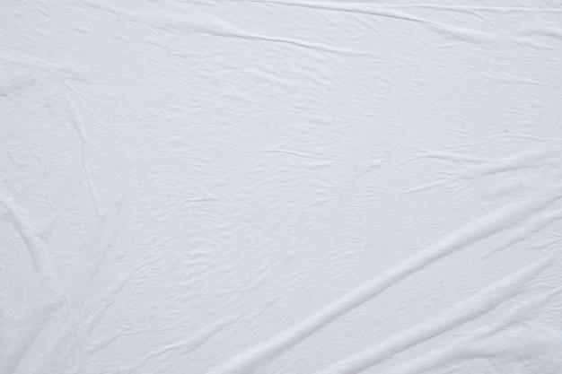 Fondo bianco vuoto di struttura del manifesto di carta stropicciata e sgualcita