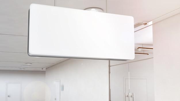 Mockup di segnaletica a luce bianca vuota appeso al soffitto