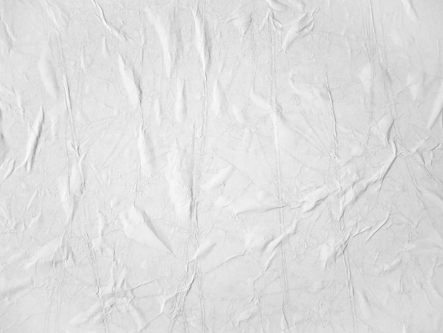 Texture di carta bianca bianca incollata sul muro