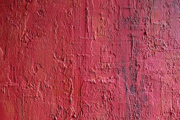 Muro di cemento in pietra fredda di sangue con stile vintage grunge e aspetto non finito con colore rosso sporco