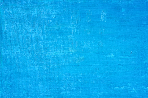 La pittura astratta blu con un pennello e le trame di colore di olio colorano le linee del disegno di olio sul fondo della tela