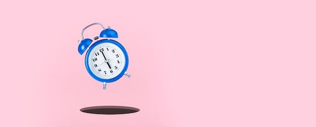 Sveglia blu su sfondo rosa, tempo di caduta