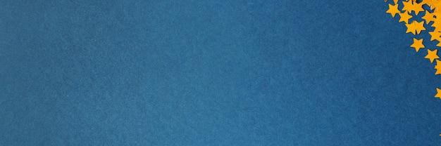 Sfondo blu con stelle dorate. anno nuovo o buon natale texture
