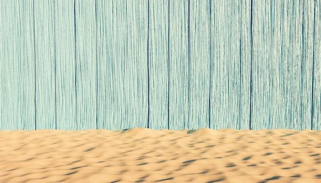 Sfondo blu legno malconcio con spiaggia di sabbia di fronte