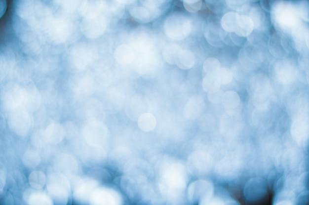 Sfondo sfocato blu con luci sfocate