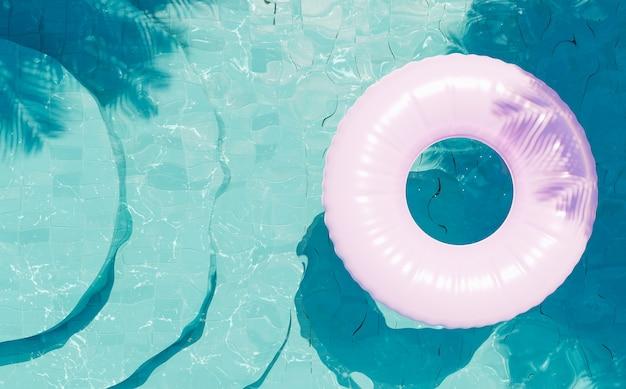 Piscina con fondo blu con scale rotonde viste dall'alto con un galleggiante rosa e l'ombra delle palme. rendering 3d