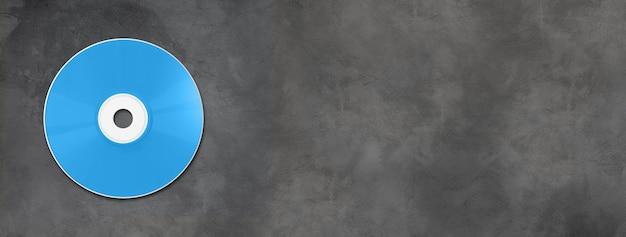 Blue cd - modello di mockup etichetta dvd isolato su banner orizzontale in calcestruzzo