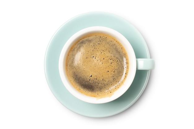 Primo piano blu di vista superiore della tazza di caffè isolato su fondo bianco.