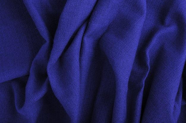 Colore blu consistenza delle onde di stoffa tessile dipinta