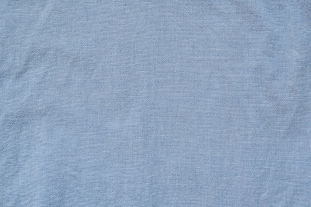 Tessuto senza cuciture in cotone blu. sfondo trama