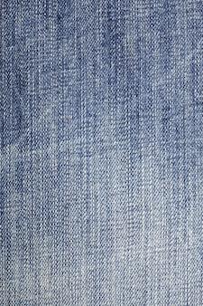 Fondo blu di struttura dei jeans del denim.