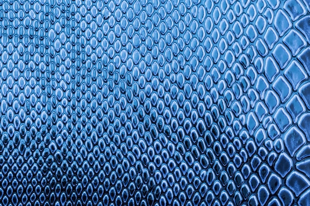 Modello di pelle di serpente esotico blu come sfondo