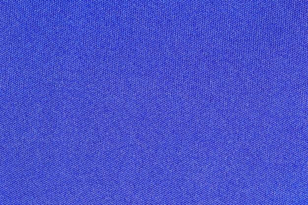 Priorità bassa di struttura del poliestere panno tessuto blu.