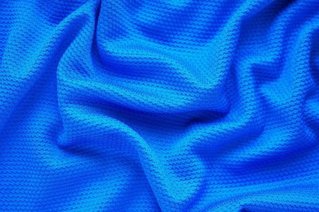 Fondo blu di usura di sport di struttura del tessuto dell'abbigliamento della maglia da calcio