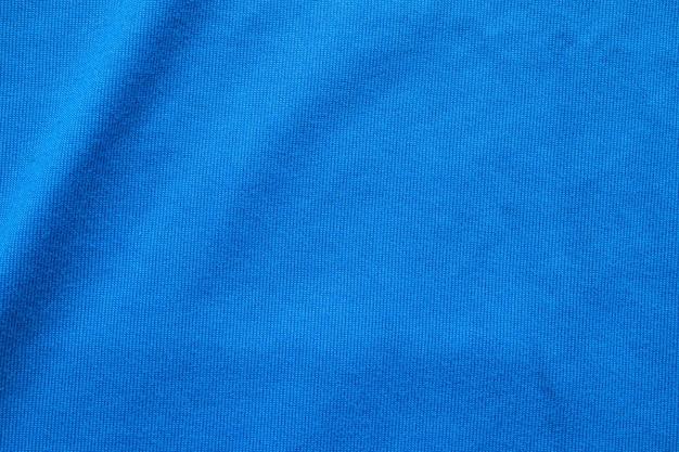 Fondo blu di usura di sport di struttura del tessuto dell'abbigliamento della maglia di calcio