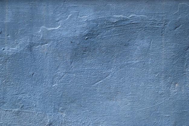 Struttura concreta blu e grigia, fondo dipinto approssimativo. sfondo di architettura grunge. superficie solida irregolare.
