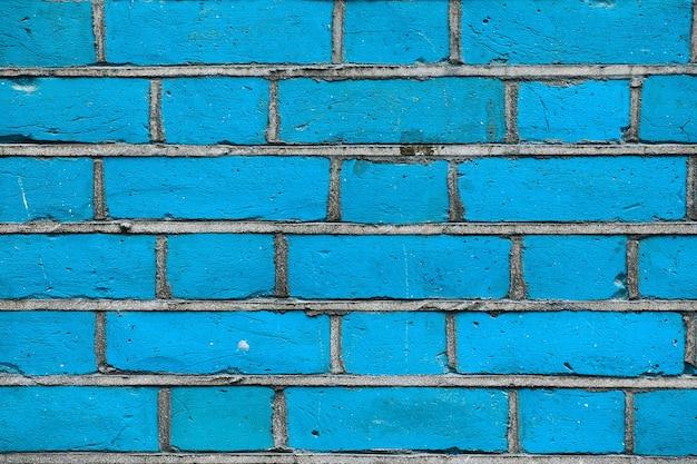 Struttura del fondo del muro di mattoni blu del grunge