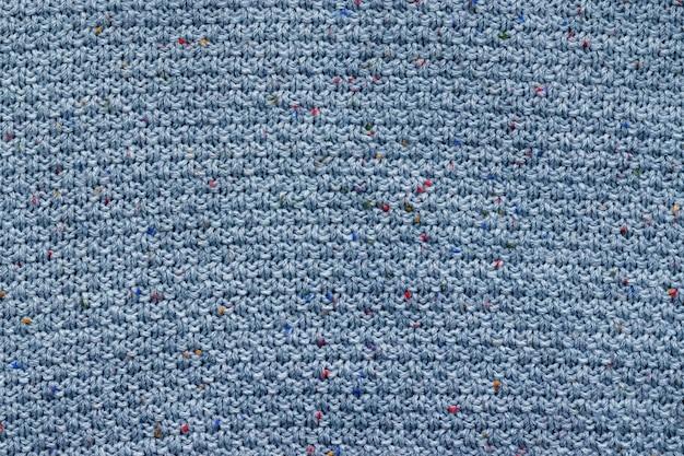 Trama di tessuto a maglia blu. sfondo maglione ruvido