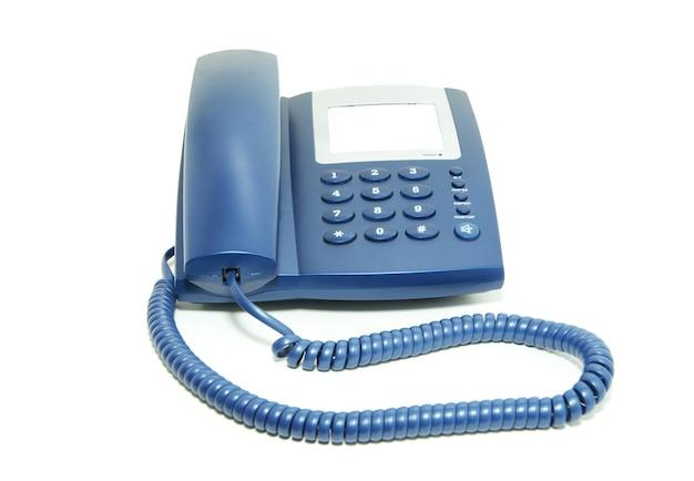 Telefono dell'ufficio blu su sfondo bianco