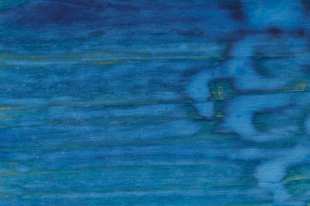 Vernice blu su una superficie di legno. sfondo per il design