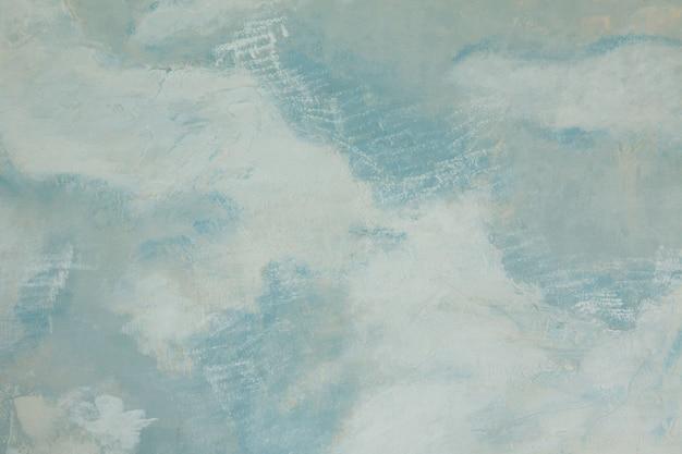 Blu dipinto sul muro bianco, sfondo texture astratta