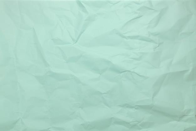 Fondo di struttura di carta blu fondo di forma astratta di carta stropicciata con carta spaziale per testo cru...