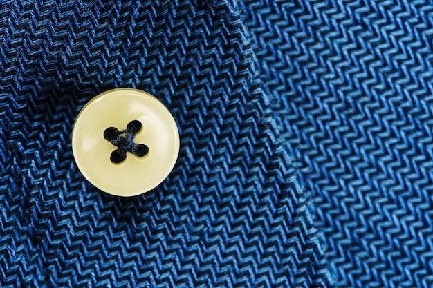 Tessuto camicia blu con bottone