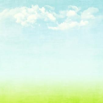 Cielo blu, nuvole e campo verde estate grunge astratto sfondo