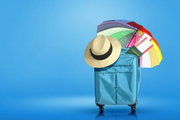 Valigia, cappello, biglietto e passaporto blu con ombrello con sfondo colorato