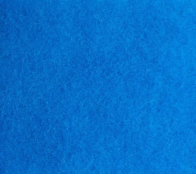 Trama blu di una spugna da cucina con fibre, telaio completo