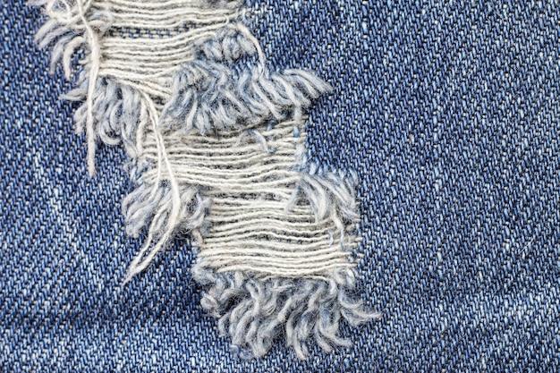 Trama di jeans denim strappato blu