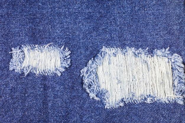 Struttura dei jeans denim strappati blu
