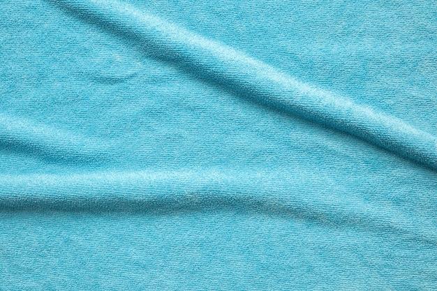 Superficie di struttura del tessuto asciugamano blu vicino sfondo
