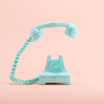 Telefono vintage blu su sfondo di colore pastello rosa. concetto di idea minima.