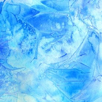 Sfondo acquerello blu con macchie e pennellate. struttura del gelo invernale.