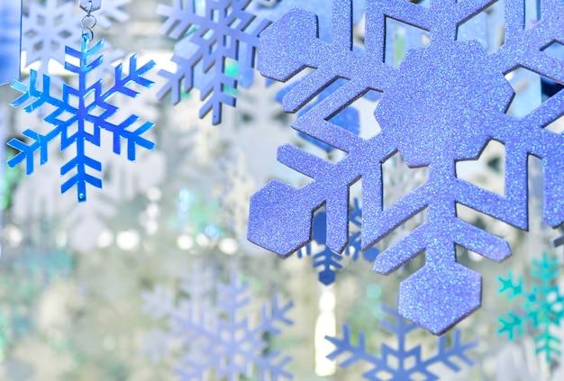 Sfondo di natale fiocco di neve blu e bianco