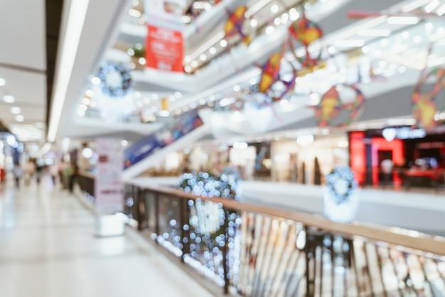 Sfocatura centro commerciale di lusso e negozi al dettaglio