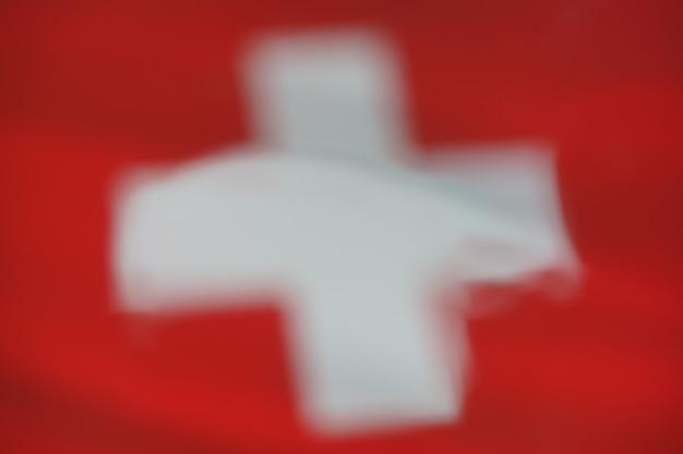 Sfocatura goccia d'acqua della bandiera svizzera per lo sfondo del design