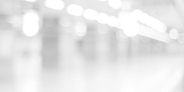 Priorità bassa in bianco e nero vaga: sfocatura ufficio con bokeh sfondo chiaro