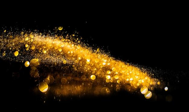 Bombe glitterate sfocate, glitter oro sfocato astratto sfondo grunge di luci scintillanti.